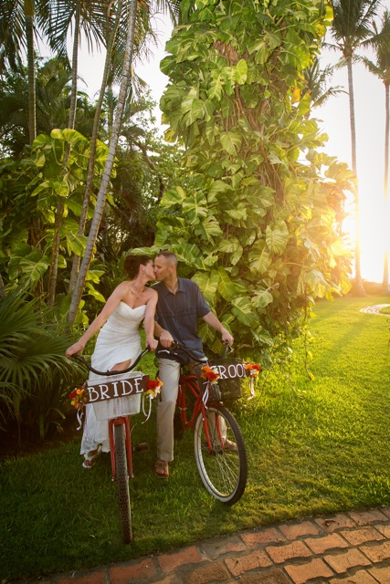 Couple kissing on bikes