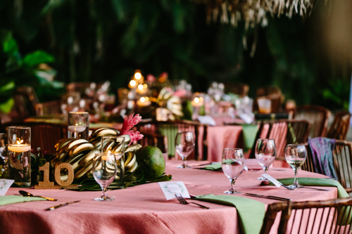 Pink, green, gold tropical rehearsal dinner
