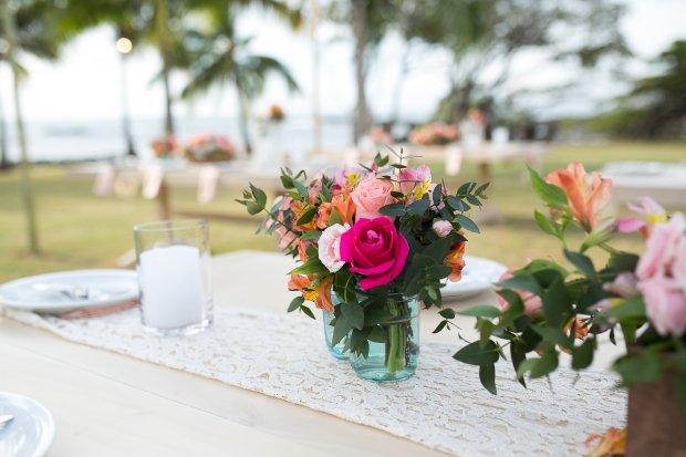 beach wedding, wedding reception, flower arrangement, tropical flowers, Hacienda Pinilla Beach Resort, las palapas, weddings costa rica