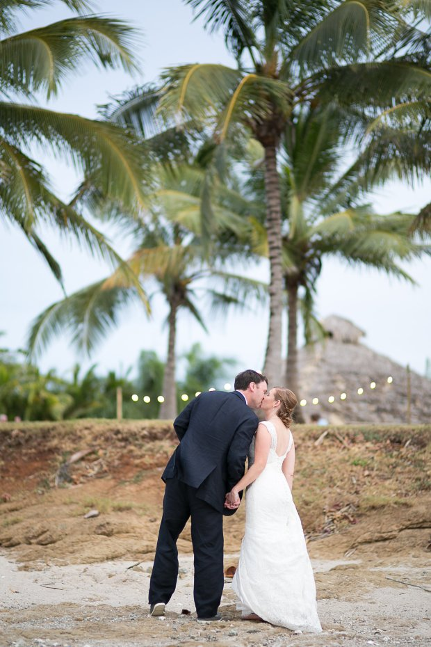 bride and groom kissing, newlyweds, tropical wedding, beach wedding, wedding palmtrees, Hacienda Pinilla Beach Resort, las palapas, weddings costa rica