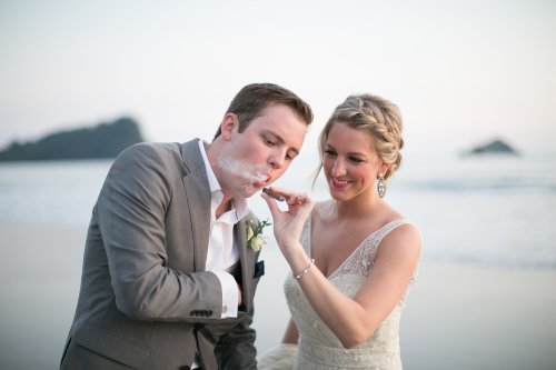 bride and groom with cigar, costa rica cigars, beach wedding, smoking groom, newlyweds at beach, discovery beach house manuel antonio, weddings costa rica