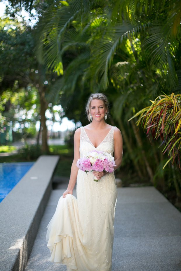 bride with pink peony bouquet, tropical wedding, destination wedding, discovery beach house manuel antonio, weddings costa rica