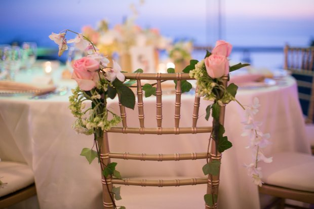wedding chair, chair back flowers, chair back roses, wedding reception, discovery beach house manuel antonio, weddings costa rica