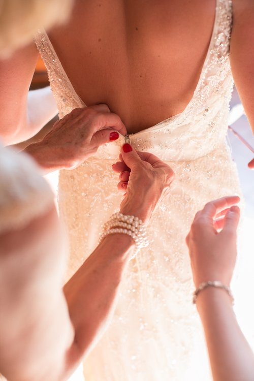 wedding preparations, wedding dress, wedding dress fitting, discovery beach house manuel antonio, weddings costa rica