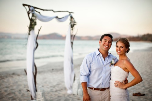 bride and groom on beach, beach wedding, wedding arch, playa conchal, Reserva Conchal Beach Club, Weddings Costa Rica