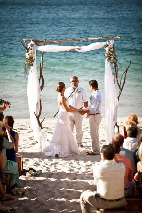 beach wedding, wedding ceremony, beach wedding ceremony, tropical wedding, wedding arch, Reserva Conchal Beach Club, Weddings Costa Rica
