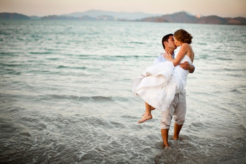 beach wedding, bride and groom kissing, romantic wedding, guanacaste, playa conchal, Reserva Conchal Beach Club, Weddings Costa Rica