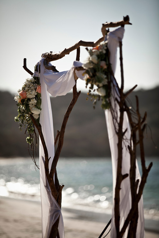 wedding arch, beach wedding, driftwood arch, rose bouquets, Reserva Conchal Beach Club, Weddings Costa Rica