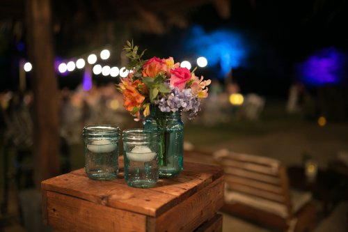 tropical wedding, tropical flower arrangement, floating candles, tropical flowers, Hacienda Pinilla Beach Resort, las palapas, weddings costa rica