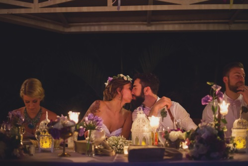 bride and groom, bride and groom kissing, purple themed wedding, purple wedding, tulemar, weddings costa rica