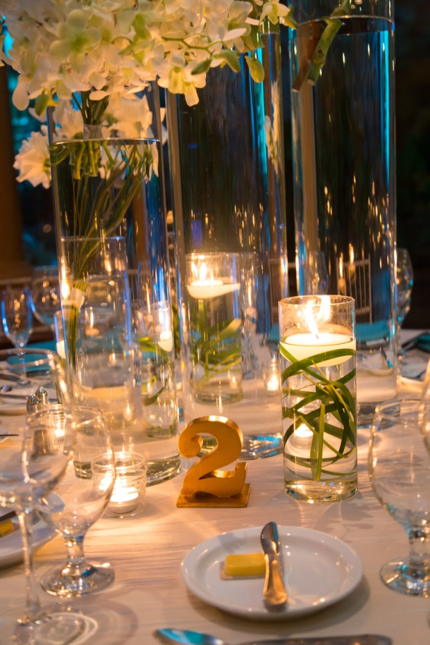 table number, white hydrangeas, wedding reception, floating candles, table decor, weddings costa rica