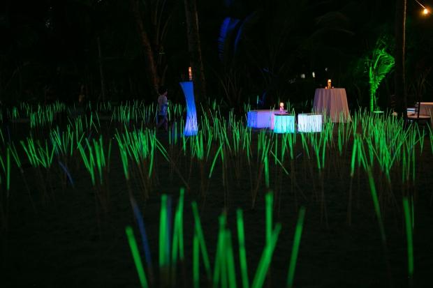 Neon fields, glow furniture, glow sticks, beach wedding