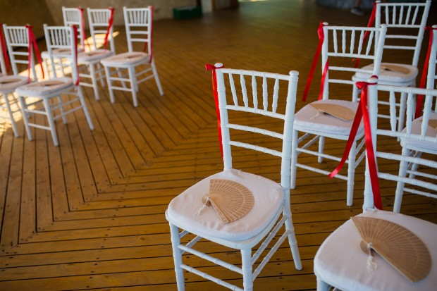wedding ceremony, wedding ceremony chairs, chairs with fans, tropical wedding, weddings costa rica