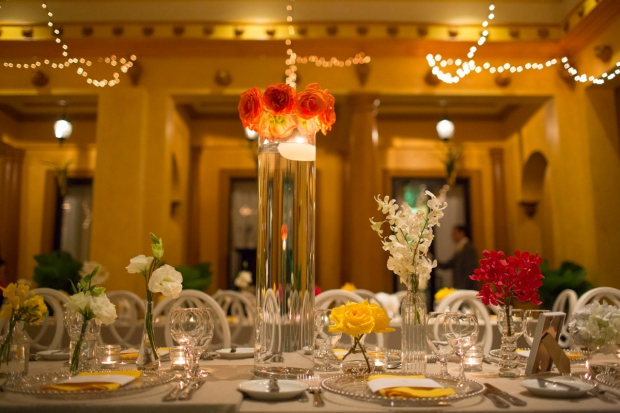 Zepher Palace, white and yellow table decor, giant tube vase with roses, weddings costa rica
