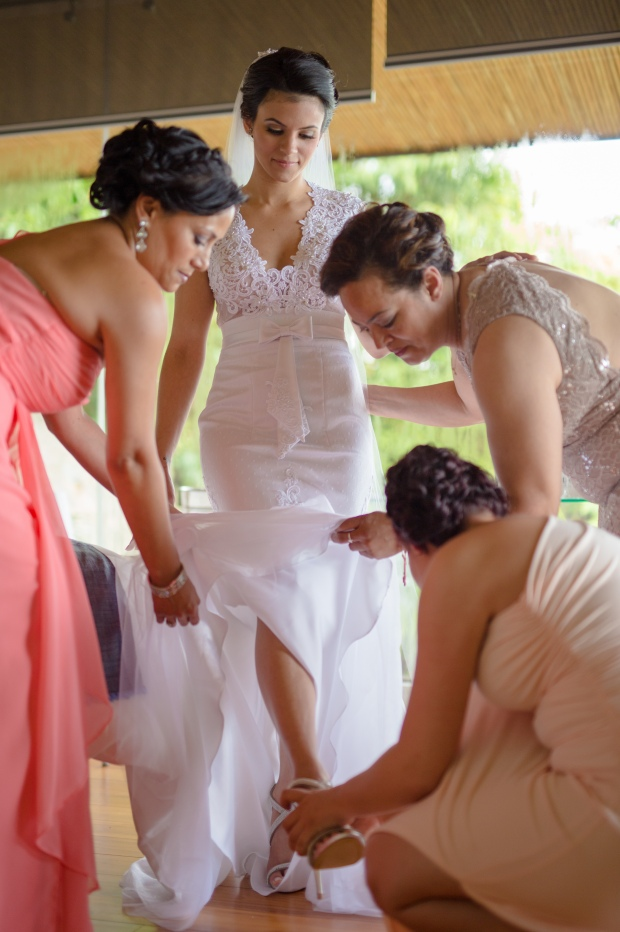 bride putting on shoes, bride and bridesmaids, weddings costa rica