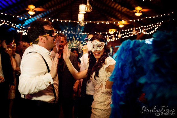 bride and groom with masks, bride and groom dancing, wedding dance, wedding dance party, weddings costa rica