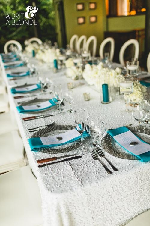 white and aquamarine table decor  white flower table