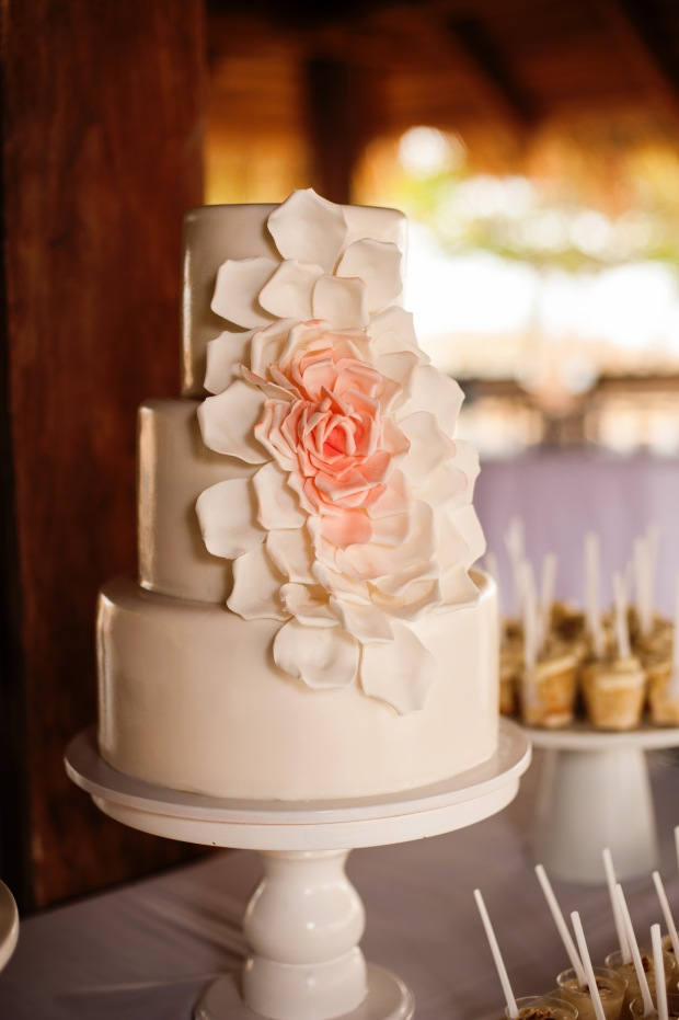 white wedding cake with ombre petals
