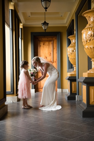 bride talking to flower girl, zephyr palace wedding, villa caletas wedding, Weddings costa rica