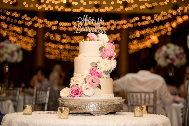 pink and white wedding reception, wedding lighting, white wedding cake, silver cake topper, wedding cake with pink and white flowers, Villa Caletas wedding, zephyr Palace wedding, Weddings Costa rica, Costa Rica wedding