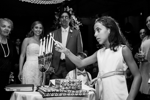 lighting menorah at wedding