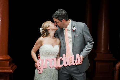 wedding couple with gracias sign